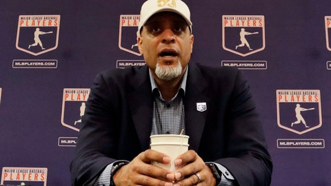 FIEL - In this Feb. 19, 2017, file photo, Tony Clark, executive director of the Major League Players Association, answers questions at a news conference in Phoenix. Clark sadi Tuesday, Feb. 6, 2018, that the number of rebuilding teams and unsigned free agents in a historically slow market threatens the very integrity of our game. Just 53 of 166 players who exercised their free agency rights last November had announced agreements entering Tuesday, down from 99 of 158 at a similar time last year. (AP Photo/Morry Gash, File)