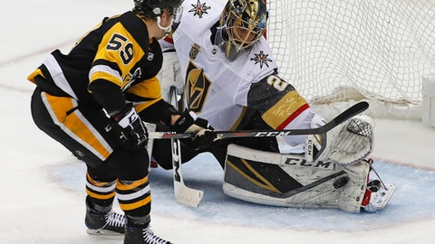 Vegas Golden Knights goaltender Marc-Andre Fleury (29) stop a shot by Pittsburgh Penguins' Jake Guentzel (59) during the first period of an NHL hockey game in Pittsburgh, Tuesday, Feb. 6, 2018. (AP Photo/Gene J. Puskar)