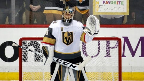 Vegas Golden Knights goaltender Marc-Andre Fleury waves to the crowd after a video tribute to his three Stanley Cups with the Pittsburgh Penguins, during the first period of an NHL hockey game in Pittsburgh, Tuesday, Feb. 6, 2018. It was Fleury's first trip back to Pittsburgh for a game since being taken in the expansion draft by the Golden Knights. (AP Photo/Gene J. Puskar)