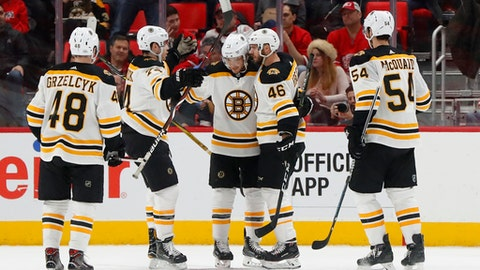 Boston Bruins center David Krejci, second from right, celebrates his goal against the Detroit Red Wings during the second period of an NHL hockey game Tuesday, Feb. 6, 2018, in Detroit. (AP Photo/Paul Sancya)