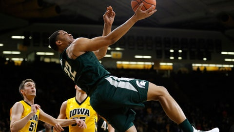 Michigan State guard Miles Bridges (22) drives to the basket past Iowa forward Nicholas Baer, left, during the first half of an NCAA college basketball game Tuesday, Feb. 6, 2018, in Iowa City, Iowa.(AP Photo/Charlie Neibergall)