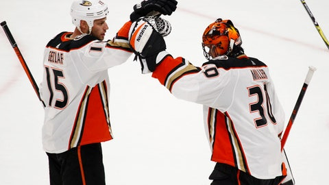 Anaheim Ducks Ryan Getzlaf (15) and Ryn Miller (30) celebrate a 4-3 victory over the Buffalo Sabres following the overtime period of an NHL hockey game, Tuesday, Feb. 6, 2018, in Buffalo, N.Y. (AP Photo/Jeffrey T. Barnes)