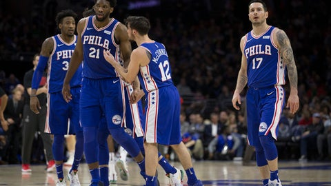 PHILADELPHIA, PA - FEBRUARY 6: Robert Covington #33, Joel Embiid #21, T.J. McConnell #12, and JJ Redick #17 of the Philadelphia 76ers walk to the bench during a timeout in the second quarter against the Washington Wizards at the Wells Fargo Center on February 6, 2018 in Philadelphia, Pennsylvania. (Photo by Mitchell Leff/Getty Images)