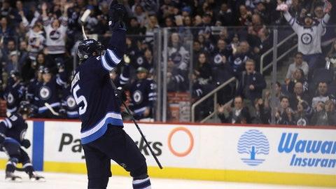 Winnipeg Jets' Dmitry Kulikov (5) celebrates after scoring against the Arizona Coyotes' during second period NHL hockey action in Winnipeg, Manitoba Tuesday, Feb. 6, 2018. (Trevor Hagan/The Canadian Press via AP)
