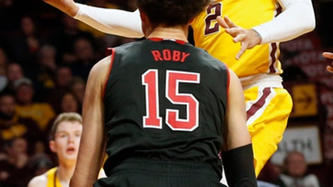 Minnesota's Nate Mason, right, lays up as Nebraska's Isaiah Roby watches in the second half of an NCAA college basketball game Tuesday, Feb. 6, 2018, in Minneapolis. Nebraska won 91-85. Roby led Nebraska with 21 points while Mason led Minnesota with 34. (AP Photo/Jim Mone)