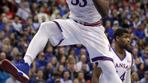 Kansas center Udoka Azubuike (35) rebounds during the second half of an NCAA college basketball game against TCU in Lawrence, Kan., Tuesday, Feb. 6, 2018. Kansas defeated TCU 71-64. (AP Photo/Orlin Wagner)