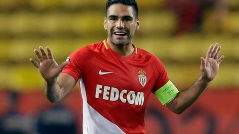 FILE - In this Tuesday, Oct. 17, 2017 file photo, Monaco's Radamel Falcao gestures during the Champions League Group G first leg soccer match between Monaco and Besiktas at Louis II stadium in Monaco.  Falcao will be out for up to three weeks after sustaining a thigh muscle injury during a 3-2 home win against Lyon on Sunday Feb. 4, 2018 . (AP Photo/Claude Paris, File)