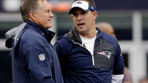 FILE - In this Oct. 2, 2016, file photo, New England Patriots head coach Bill Belichick, left, and offensive coordinator Josh McDaniels talk before an NFL football game against the Buffalo Bills in Foxborough, Mass.  McDaniels has backed out of a deal to become the Indianapolis' Colts new coach, a decision that shocked the franchise hours after it announced his hiring. The Colts confirmed McDaniels' decision in a statement Tuesday night after reports emerged that the Patriots' offensive coordinator had opted to stay in New England with coach Bill Belichick. (AP Photo/Elise Amendola, File)