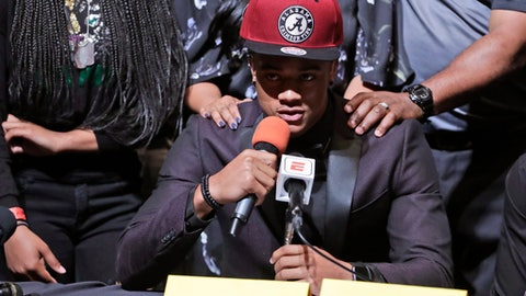 Patrick Surtain Jr., a defensive back from the football team at American Heritage High School, announces he is signing with Alabama during national signing day, Wednesday, Feb. 7, 2018, in Plantation, Fla. (AP Photo/Lynne Sladky)