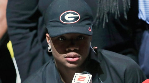 Tyson Campbell, a defensive back from the football team at American Heritage High School, announces he is signing with Georgia on national signing day, Wednesday, Feb. 7, 2018, in Plantation, Fla. (AP Photo/Lynne Sladky)