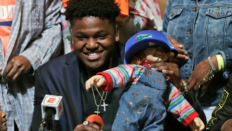 Andrew Chatfield, a defensive end from the football team at American Heritage High School, announces he is signing with Florida on national signing day, Wednesday, Feb. 7, 2018, in Plantation, Fla. (AP Photo/Lynne Sladky)