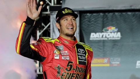 FILE - In this Feb. 18, 2017, file photo, Martin Truex Jr. waves to fans during driver introductions for the NASCAR Clash auto race at Daytona International Speedway, in Daytona Beach, Fla. Martin Truex Jr. has been all over the country during his brief reign as NASCAR's newest champion. Truex will get back behind the wheel of his No. 78 Toyota this weekend at Daytona International Speedway and he'll race Sunday in an exhibition all-star event. It will be the first look at the Colorado-based Furniture Row Racing team since it manhandled the competition all last year. (AP Photo/Terry Renna, File)