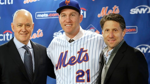 New York Mets general manager Sandy Alderson, left, poses with newly signed Mets third baseman Todd Frazier, center, and Mets owner Jeff Wilpon after the former New York Yankees player signed with the Mets, Wednesday, Feb. 7, 2018, in New York. Frazier reportedly signed a two-year deal, finalized on Wednesday. The contract calls for Frazier to be paid $8 million this year and $9 million in 2019. (AP Photo/Kathy Willens)