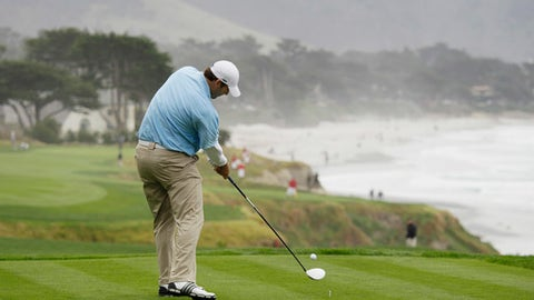 Dallas Cowboys quarterback Tony Romo hits from the 10th tee of the Pebble Beach Golf Links during the AT&T Pebble Beach National Pro-Am golf tournament in Pebble Beach, Calif. Romo has accepted an exemption to play a PGA Tour event in March in the Dominican Republic. (AP Photo/Eric Risberg)