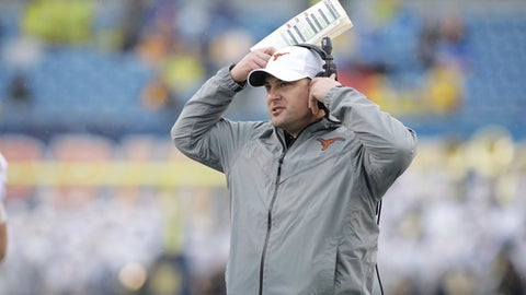 FILE - This Nov. 18, 2017 file photo shows Texas head coach Tom Herman watching his team from the sidelines during the first half of an NCAA college football game against West Virginia in Morgantown, W.Va. Herman and the Texas Longhorns have one of the top signing classes in the nation, not just in the best in the Big 12. After a winning record on the field in Hermans first season, the Longhorns also made significant strides with the coachs second recruiting class. Eight more players signed on Wednesday, Feb. 7, 2018 to bolster what was already a strong class with the 19 players added during the early signing period in December. (AP Photo/Raymond Thompson, file)