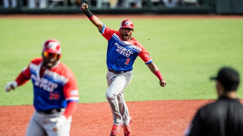 Jesmuel Valentin of Puerto Rico's Criollos de Caguas celebrates a home run during a Caribbean Series baseball game against Venezuela's Caribes de Anzoategui in Guadalajara, Mexico, Wednesday, Feb. 7, 2018. (AP Photo/Luis Gutierrez)