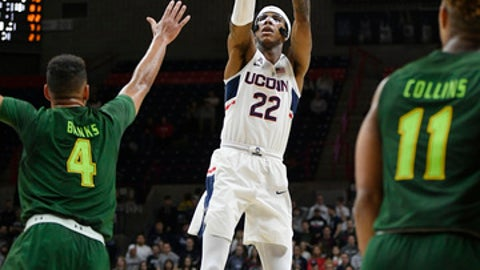 Connecticut's Terry Larrier shoots over South Florida's Payton Banks, left, during the second half an NCAA college basketball game, Wednesday, Feb. 7, 2018, in Storrs, Conn. (AP Photo/Jessica Hill)