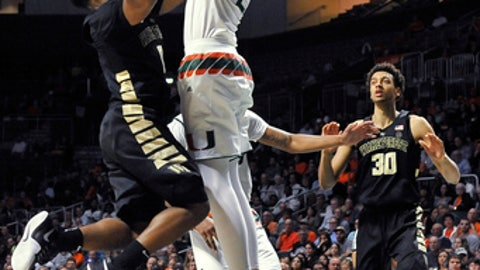 Wake Forest's Brandon Childress goes up for a shot against Miami Sam Waardenburg during the second half action of an NCAA college basketball game in Coral Gables, Fla., Wednesday Feb. 7, 2018. Miami won 87-81. (AP Photo/Gaston De Cardenas)