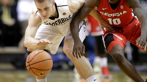 Georgia guard Teshaun Hightower (10) tries to steal the ball from Vanderbilt guard Riley LaChance, left, in the second half of an NCAA college basketball game Wednesday, Feb. 7, 2018, in Nashville, Tenn. Vanderbilt won 81-66. (AP Photo/Mark Humphrey)
