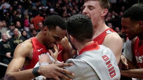 Ohio State forward Keita Bates-Diop, left, celebrates with teammates Andrew Dakich, right, and Joey Lane after defeating Purdue 64-63 in an NCAA college basketball game in West Lafayette, Ind., Wednesday, Feb. 7, 2018. (AP Photo/AJ Mast)