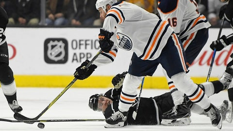 Los Angeles Kings left wing Tanner Pearson, below, reaches for the puck along with Edmonton Oilers right wing Zack Kassian during the second period of an NHL hockey game Wednesday, Feb. 7, 2018, in Los Angeles. (AP Photo/Mark J. Terrill)