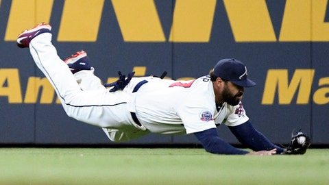 FILE - In this Sept. 9, 2017, file photo, Atlanta Braves left fielder Matt Kemp makes a diving catch of a ball hit by Miami Marlins' Marcell Ozuna during the seventh inning of a baseball game in Atlanta. The Dodgers sent 1B Adrian Gonzalez, pitchers Scott Kazmir and Brandon McCarthy, and utility man Charlie Culberson, along with $4.5 million, to Atlanta for Kemp, a former Dodger who could be traded or released. (AP Photo/John Amis, File)