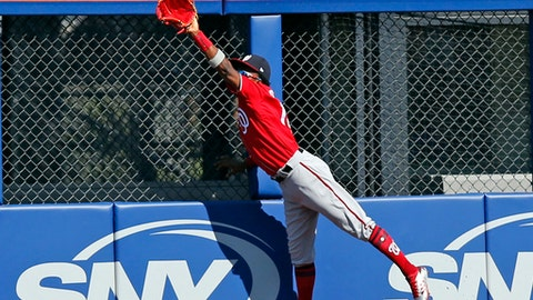 FILE - In this Sept. 24, 2017, file photo, Washington Nationals right fielder Victor Robles (14) hauls in a fly ball hit by New York Mets batter Jose Reyes during the first inning of a baseball game in New York. Two players who could make an impact for the Nationals are 26-year-old pitcher A.J. Cole, who has 22 career appearances in the majors and could be the No. 5 starter, and 20-year-old outfielder Victor Robles, who made the postseason roster in 2017 despite only 24 at-bats for Washington.  (AP Photo/Kathy Willens, File)