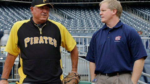 FILE - In this Oct. 5, 2013, file photo, Pittsburgh Pirates manager Clint Hurdle, left, chates with general manager Neal Huntington during a baseball workout at PNC Park in Pittsburgh. Huntington has a problem with the word rebuild. To the Pirates general manager, the connotation hints at raising a white flag on the present.  Rebuild implies you're looking five years down the road, Huntington said.  Which, Huntington insists, his team is not doing. (AP Photo/Gene J. Puskar, File0