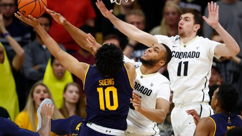 California forward Justice Sueing, left, has his shot blocked by Colorado forward Dallas Walton, center, as guard Lazar Nikolic defends during the second half of an NCAA college basketball game Wednesday, Feb. 7, 2018, in Boulder, Colo. Colorado won 68-64. (AP Photo/David Zalubowski)