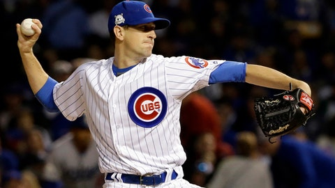 FILE - In this Oct. 17, 2017, file photo, Chicago Cubs starting pitcher Kyle Hendricks throws during the first inning of Game 3 of baseball's National League Championship Series against the Los Angeles Dodgers, in Chicago. Coming off an historic World Series title, the Cubs got off to a slow start last year and had to push themselves in the second half to overcome Milwaukee and win the NL Central. I think it just teaches you how every year is so different, Hendricks said, not just the season, but the offseason too, and how you get your body ready. (AP Photo/Nam Y. Huh, File)