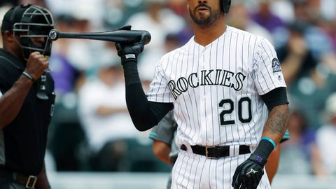 FILE - In this June 22, 2017, file photo, Colorado Rockies' Ian Desmond reacts after striking out against Arizona Diamondbacks starting pitcher Zack Godley to end the bottom of the fourth inning of a baseball game in Denver. The Rockies are counting on a bounce-back campaign from Desmond and shortstop Trevor Story in conjunction with big seasons from other position players to make a run at back-to-back playoff appearances for the first time in team history. (AP Photo/David Zalubowski, File)