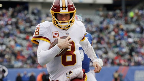 FILE - In this Dec. 31, 2017, file photo, Washington Redskins quarterback Kirk Cousins (8) rushes for a touchdown during the first half of an NFL football game against the New York Giants in East Rutherford, N.J. The quarterback carousel began in the days before the Super Bowl when Kansas City agreed to trade Alex Smith to the Redskins. The deal, which cannot be finalized until March 14, spells the end of Cousins' time in Washington and hands the Chiefs' job to Patrick Mahomes III, the 10th pick in last year's draft out of Texas Tech. (AP Photo/Mark Lennihan, File)
