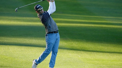 Kevin Streelman follows his shot from the first fairway of the Spyglass Hill Golf Course during the first round of the AT&T Pebble Beach National Pro-Am golf tournament Thursday, Feb. 8, 2018, in Pebble Beach, Calif. (AP Photo/Eric Risberg)