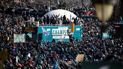Fans cheer as a bus with team members arrives near the Philadelphia Museum of Art during a Super Bowl victory parade for the Philadelphia Eagles football team, Thursday, Feb. 8, 2018, in Philadelphia. The Eagles beat the New England Patriots 41-33 in Super Bowl 52. (AP Photo/Alex Brandon)