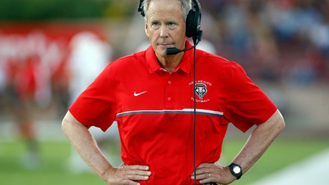 FILE - In this Sept. 10, 2016, file photo New Mexico coach Bob Davie walks in the sideline during the first half of an NCAA college football game against New Mexico State in Las Cruces, N.M. The University of New Mexico suspended Davie on Thursday, Feb. 8, 2018, for 30 days without pay, following multiple investigations that examined whether he and coaching staff interfered with criminal investigations or misconduct cases involving players. (AP Photo/Andres Leighton, File)
