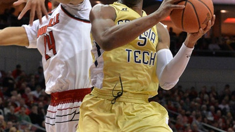 Georgia Tech guard Josh Okogie (5) avoids Louisville forward Dwayne Sutton (24) as he drives to the basket during the first half of an NCAA college basketball game Thursday, Feb. 8, 2018, in Louisville, Ky. (AP Photo/Timothy D. Easley)