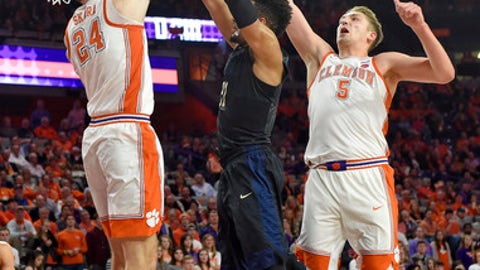 Clemson's David Skara, left, and Mark Donnal, right, pressure Pittsburgh's Terrell Brown under the basket during the first half of an NCAA college basketball game Thursday, Feb. 8, 2018, in Clemson, S.C. (AP Photo/Richard Shiro)