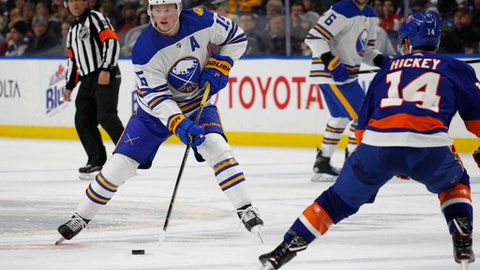 Buffalo Sabres forward Jack Eichel (15) skates upice as New York Islanders Thomas Hickey (14) defends during the second period of an NHL hockey game, Thursday, Feb. 8, 2018, in Buffalo, N.Y. (AP Photo/Jeffrey T. Barnes)
