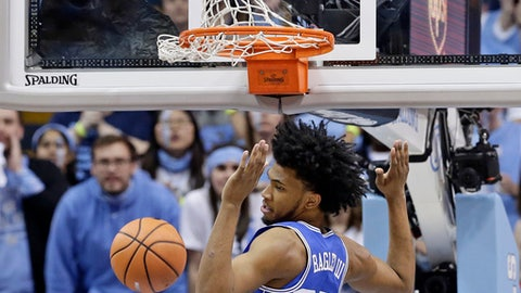 Duke's Marvin Bagley III (35) dunks against North Carolina during the first half of an NCAA college basketball game in Chapel Hill, N.C., Thursday, Feb. 8, 2018. (AP Photo/Gerry Broome)