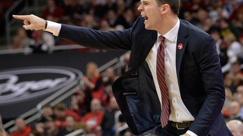 Louisville interim coach David Padgett shouts instructions to his team during the second half of an NCAA college basketball game against Georgia Tech, Thursday, Feb. 8, 2018, in Louisville, Ky. Louisville won 77-54. (AP Photo/Timothy D. Easley)