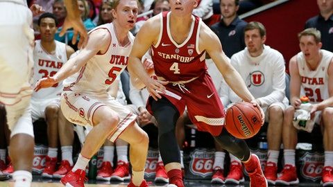 Stanford guard Isaac White (4) drives to the basket as Utah guard Parker Van Dyke (5) defends during the first half of an NCAA college basketball game Thursday, Feb. 8, 2018, in Salt Lake City. (AP Photo/Rick Bowmer)