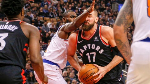 TORONTO, ON - FEBRUARY 8  -  Jonas Valanciunas (17) of the Raptors gets an arm in the face from Tim Hardaway Jr. (3) of the Knicks during the 1st half of NBA action as the Toronto Raptors host the New York Knicks at the Air Canada Centre on February 8, 2018.        (Carlos Osorio/Toronto Star via Getty Images)