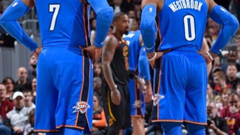 CLEVELAND, OH - JANUARY 20: Carmelo Anthony #7 and Russell Westbrook #0 of the Oklahoma City Thunder look on during the game against the Cleveland Cavaliers on January 20, 2018 at Quicken Loans Arena in Cleveland, Ohio. (Photo by David Liam Kyle/NBAE via Getty Images)