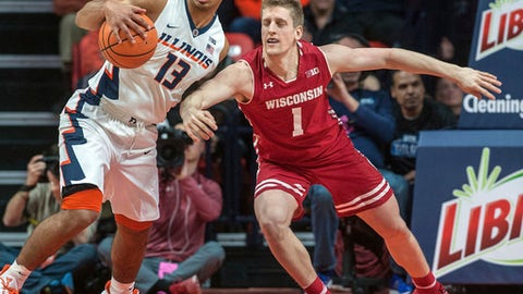 Illinois guard Mark Smith (13) grabs  the ball away from Wisconsin guard Brevin Pritzl (1) during the first half of an NCAA college basketball game in Champaign, Ill., on Thursday, Feb. 8, 2018. (AP Photo/Rick Danzl)