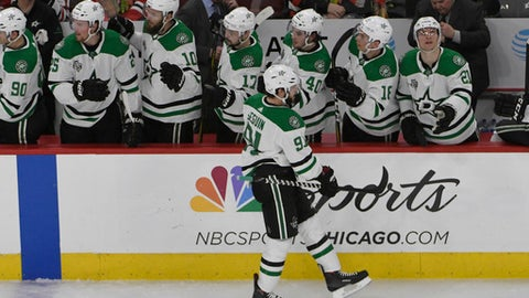 Dallas Stars center Tyler Seguin (91) celebrates his goal against the Chicago Blackhawks with his teammates during the second period of an NHL hockey game Thursday, Feb. 8, 2018, in Chicago. (AP Photo/David Banks)