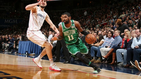 WASHINGTON, DC - FEBRUARY 8: Kyrie Irving #11 of the Boston Celtics handles the ball during the game against the Washington Wizards on February 8, 2018 at Capital One Arena in Washington, DC. (Photo by Ned Dishman/NBAE via Getty Images)