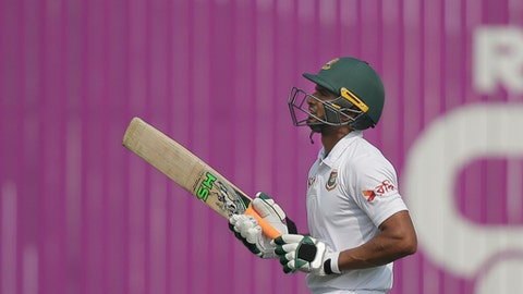 Bangladesh's captain Mahmudullah walks back to the pavilion after his dismissal by Sri Lanka's Akila Dananjaya during the second day of the second and final test cricket match in Dhaka, Bangladesh, Friday, Feb. 9, 2018. (AP Photo/A.M. Ahad)