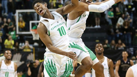 Oregon's Victor Bailey Jr., left, celebrates with Kenny Wooten after Oregon defeated Washington 65-40 in an NCAA college basketball game Thursday, Feb. 8, 2018, in Eugene, Ore. (AP Photo/Chris Pietsch)