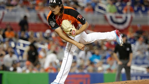 FILE- In this July 9, 2017, file photo, U.S. Team pitcher Brent Honeywell, of the Tampa Bay Rays, throws during the first inning of the All-Star Futures baseball game against the World Team in Miami. Honeywell, one the club's top minor league prospect, has a chance of earning a spot on the Rays' roster coming out of spring training. (AP Photo/Lynne Sladky, File)