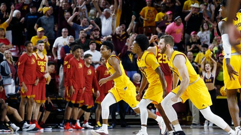 Arizona State's Mickey Mitchell, right, Shannon Evans II, middle, and guard Tra Holder, left, celebrate as time expires during an NCAA college basketball game against Southern California Thursday, Feb. 8, 2018, in Tempe, Ariz. Arizona State defeated Southern California 80-78. (AP Photo/Ross D. Franklin)